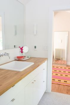 Ikea *kitchen* cabinets in the bathroom provide more storage than a traditional vanity