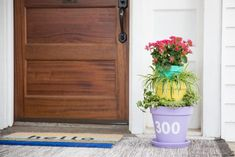 A planter and house number all in one, this simple DIY will have your guests and your postman drooling.