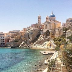 The Wonderful town of Ermoupolis , at Syros island (Σύρος) . It's the capital of Syros as well as of the Cyclades islands . Amazing neoclassical architecture in combination with the sun .