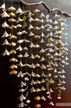 Hanging origami lillies. possible backdrop decor for my arch!