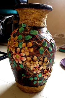 musa this is a pot decorated with flowers made of plaster of parispop