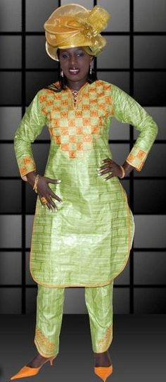 Let your beauty dazzle in this one of a kind African women's dress for all occasions, with its bright lime green color and orange embroidery.    Made with 100% authentic cotton brocade.   Please DO NOT bleach, dry clean and press with warm iron.   Fabric: Brocade   Sizes available: 0-32W   Sleeve...