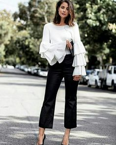 TIP: pair a ruffled, ultra feminine top with leather trousers