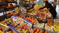A woman browses a market stall