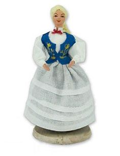 Kaszubska Girl - This traditional Polish doll is completely hand made the old fashioned way with papier mache, dress materials and paints.  The doll is clothed in authentic regional folk costume