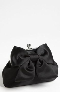 Tuxedo: A large, playful bow tops this Sondra Roberts satin clutch.