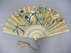 Japanese late 19th century fan with carved ivory sticks.