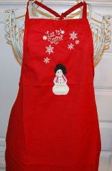 Sport this cute holiday apron while you prepare Christmas dinner for the family. This easy Christmas craft requires basic sewing skills. It makes a great Christmas gift or fun Christmas craft with your friends.