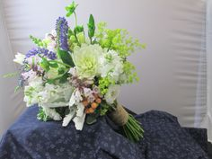 Mostly whites spring bridal bouquet. Wild flower look. Local dahlias. Penstemon. Tied off in twine. Late June.