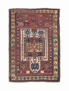 A KAZAK PRAYER RUG -   SOUTH CAUCASUS, DATED AH1289 / 1872-73AD -   The ivory field with hooked medallions above and below a central square sea-green panel with a golden yellow centre with tomato-red hooked motifs in a tomato-red frame decorated with polychrome hooked motifs and linked polchrome jewelled motif, in a golden yellow  hooked vine border between reciprocal zig-zag stripes and barber-pole minor stripes  5 ft. 4 in. x 3 ft. 9 in. (163 cm. x 114 cm.)