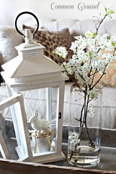 Decor: Create a lovely vignette by picking up a lantern from a home accessory store, adding a favorite trinket and fresh flowers - FRENCH COUNTRY COTTAGE: Feathered Nest Friday French Country Cottage, Country Farmhouse Decor, French Country Decorating, Cottage Farmhouse, Country Houses, Farmhouse Style, Living Room Ornaments, Home Accessories Stores, Interior Room Decoration