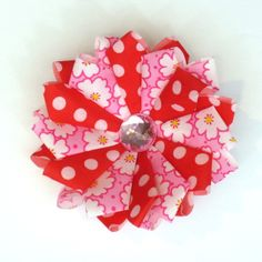 Watch this tutorial video to create a Fablossom Daisy fabric flower! #Fablossom