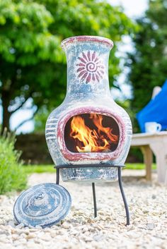 This patio heater includes a rain lid and steel stand. Clay body and lid. Red Detailing On Blue. Chimnea, Mexican Patio, Small Outdoor Spaces, Fire Bowls, Patio Heater, Exterior, Red Accents, New Homes, Home And Garden
