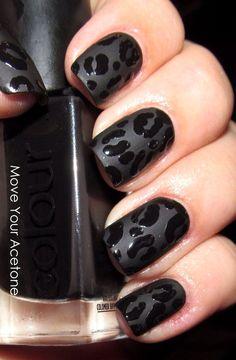 Black on black print nail art design