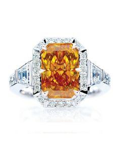 "Platinum ring featuring a rare, 3.16-carat, radiant orange diamond, dubbed ""Here Comes the Sun"""