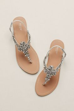Adorned with an elegant pattern of crystals, these T-strap flats are a gorgeous way to wear sandals to a summer wedding or soiree.  Crafted in China