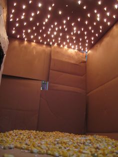 Christmas lights through a cardboard box! Awesome fort!