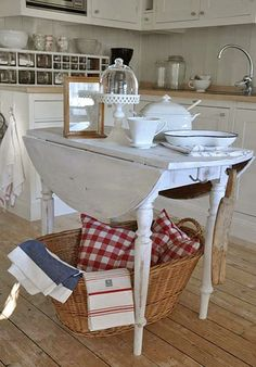Love this drop leaf table for an island
