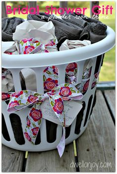 Bridal shower gift.  When buying towels of the registry - wrap them in a laundry basket!
