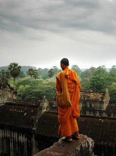 Buddhist monk at prayer, Angkor Wat