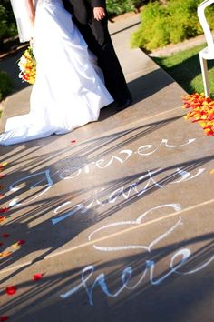 """Really cool wedding aisle decoration idea. """"Forever Starts Here"""" written in chalk."""