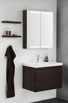 Nice layout with the warm coffee colour, integrated handles and spacious mirror cabinet. Combine with our floating shelves.