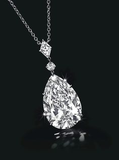 Pendant with 24.53-carat pear-cut diamond and two further diamonds, on a platinum chain.