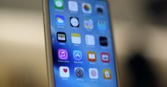 A new Apple iPhone is displayed at an Apple store on Chicago's Magnificent Mile, Friday, Sept. Iphone Se, Apple Iphone, Smartphone, Ipad, Telephone, Internet, Samsung, Simple, Applications