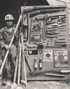 Korean War, Korea, 1950-1953 Photographer Unidentified *The weapons display is probably for RoK (Republic of Korea) forces training. Notice the american equipment (The Republic of Korea forces were supplied by America so naturally they were trained with american weapons and equipment