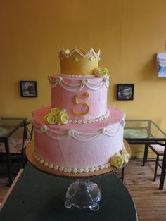 Pink Princess Birthday cake with white sway, gold crown and rolled yellow fondant roses