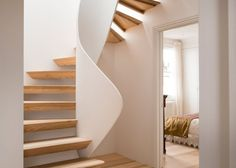 Casa Vota by London studio 51 Architecture who has combined digital fabrication with boatbuilding techniques to create a sculptural timber staircase at the centre of a family home U Shaped Staircase, Timber Staircase, New Staircase, Wooden Staircases, Staircase Design, Stair Design, Staircase Ideas, Stairs Measurements, Architecture Design