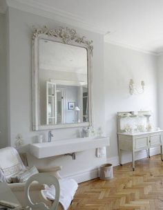 This bath is so beautiful...so serene.  I love the oversize mirror and the sink - photo courtesy of blog, Belgian Pearls