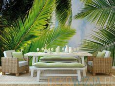 Fototapeta z liśćmi palmy na tle błękitnego nieba