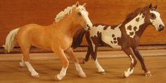 Schleich pinto stallion (original to the right) repainted into a palomino horse