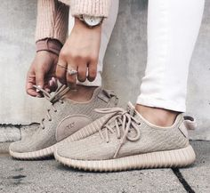 $32 - $299 All nude yeezy sneakers you can pair with cozy white pants and pastel sweaters for a complete urban look.