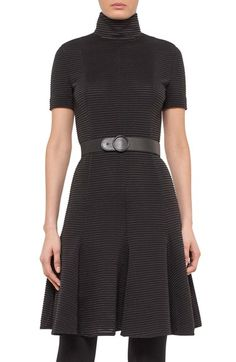 Free shipping and returns on Akris punto Ribbed Stretch Jersey Dress at Nordstrom.com. A high, face-framing mock collar furthers the modernist vibe of a short-sleeve dress expertly tailored from Italian stretch jersey textured with raised ribbing. An elasticized belt put focus on the narrowest part of the figure, helping to accentuate the belled shape of the seam-flared skirt.