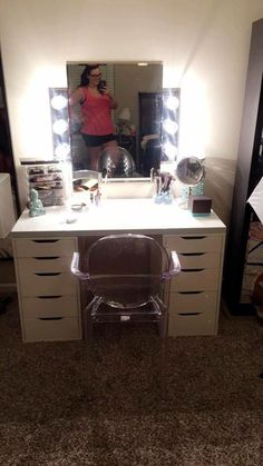 Super cute and functional DIY vanity. This girl got the drawers and the table top from IKEA and the mirror and the lights she made from supplies purchases at Lowe's. Super cheap and beautiful and so bright! Says it does not make her or the room super hot. She's going to be making a video about it. @lessbodymoreheart