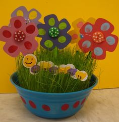 Mother's Day Flowers/ wheat grass + paper craft. I would use handprint