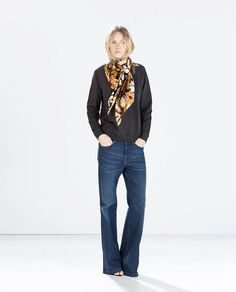 Add interest to a basic sweater and jeans look with a colorful scarf // Zara Basic Sweatshirt  + Printed Scarf in Ochre