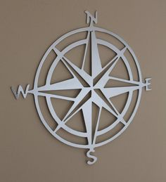 Hang this metal compass rose inside or outside your home and let it guide you with the rest of your home decor choices. This compass rose is 11.5 inches in diameter. Choose from black, hammered sliver, off-white, burgundy, or hammered copper .  Purchase a set of 3 Nautical themed items and SAVE $13! Items include: Compass rose, sailing ship, ships wheel, anchor, & lighthouse  FREE shipping