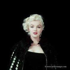Color photo of Marilyn Monroe wearing a black cape taken by #MiltonGreene in New York  in 1955.