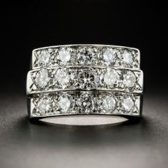 Triple your sparkle with this fabulous 1/2 inch wide band ring packed to the hilt with 1.85 carats of bright white, high-quality round brilliant-cut diamonds. Scintillating from within three horizontal rows, the center row slightly rises above the outer rows. Sturdily crafted in gleaming 14K white gold. A knockout! Currently ring size 5.