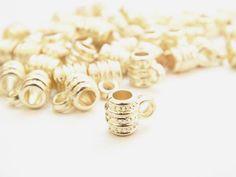 SEPP8001 Separador Barril con asa, color dorado (plastimetal), medida7mm x 4mm, precio x 30 piezas $10 pesos, precio 50 piezas)$15 pesos, precio 100 piezas$26 pesos