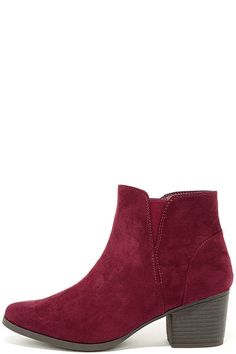"Romp around in the leaves in the Dorothy Burgundy Suede Ankle Booties! From a pointed toe upper, vegan suede travels to a notched collar with gusset for fit. 4.5"" zipper at the instep."