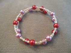 Glass Pink & Red Bracelet by LaurelMoonCreations on Etsy, $7.99