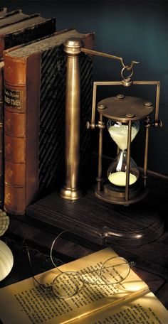 Heavyweight bronze 30 minute hourglass on wood stand. This hourglass designed for the Age of Sail, now at home in any oval or executive office