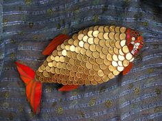 Golden fish. Made of coins and stained glass on cement (WEDI) board.