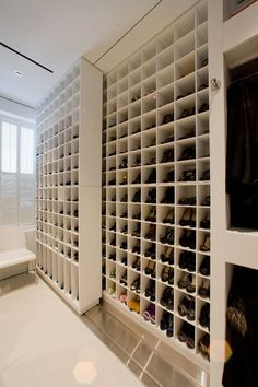 35 Beautiful Walk in Closet Designs Nice walk-in closet. It uses high-tech motion hardware. There are two color shades of shoe shelves in the room. The rest of the cabinet is also modern in design, with open white frames in plain white.