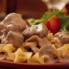 This slow cooker version of beef stroganoff uses sour cream, cream cheese, and cream of mushroom soup for a rich, savory classic main dish. Slow Cooker Beef Stroganoff Recipe, Beef Stew Meat, Slow Cooker Chili, Slow Cooker Recipes, Crockpot Recipes, Yummy Recipes, Drink Recipes, Golden Mushroom Soup, Recipes