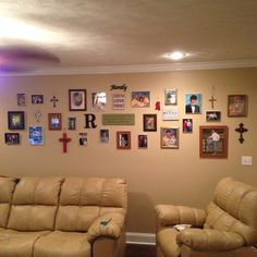 I just decorated my mother in law's blank living room wall in her newly built house with these family pics, new and old, crosses, and cute wall art I got really cheap from Wal Mart :)